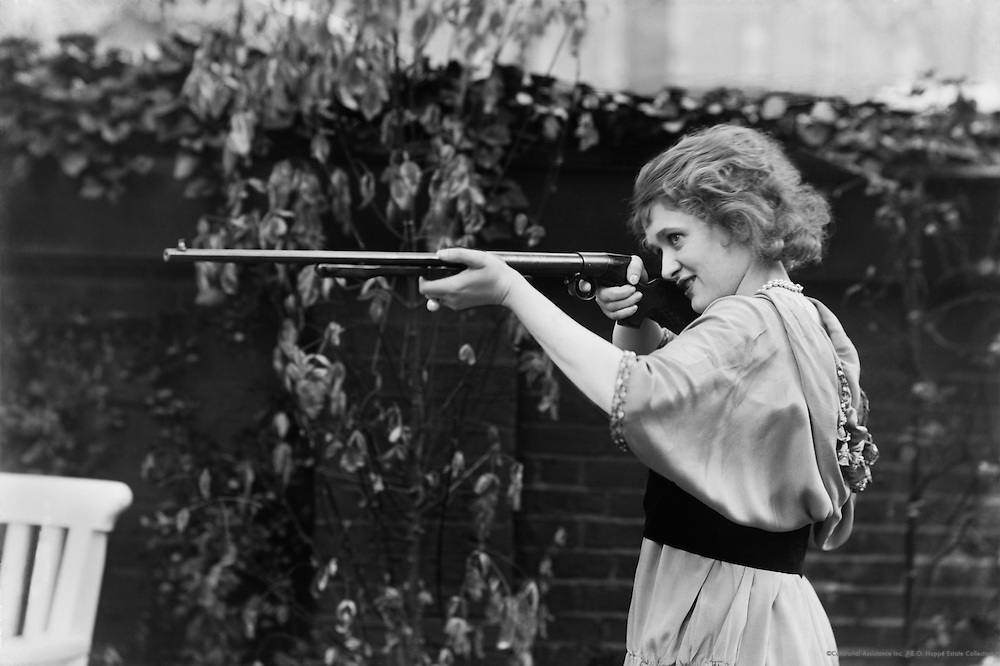 Gaby Deslys, dancer and actress, aiming a rifle, 1914