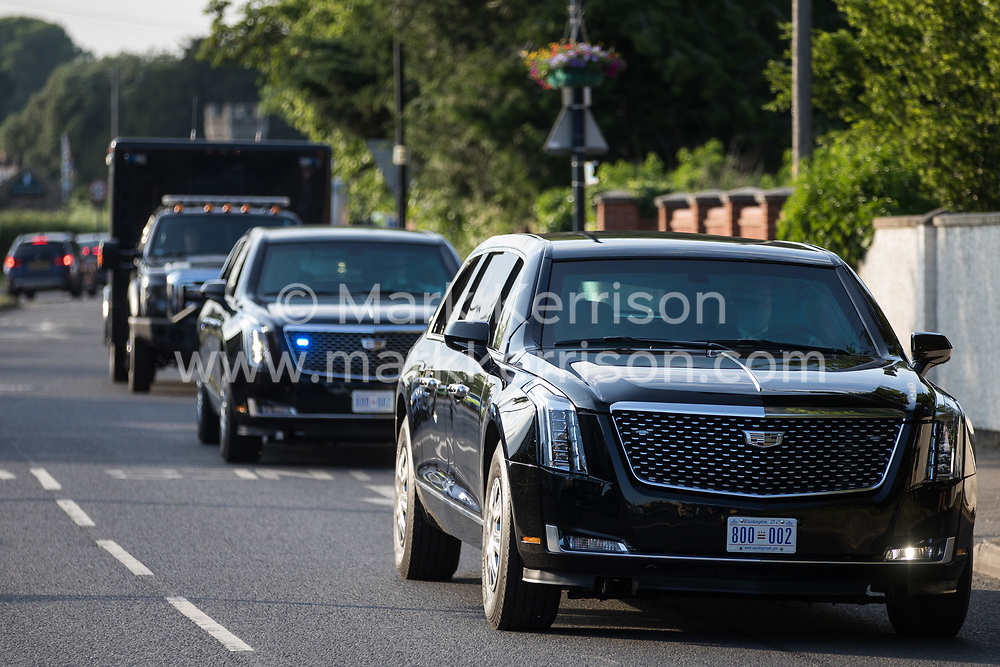 A cavalcade of vehicles led by the two Cadillacs known as the Beast leaves Windsor Castle following President Biden's visit on 13th June 2021 in Windsor, United Kingdom. President Biden and First Lady Jill Biden were welcomed by the Queen at Windsor Castle following the G7 summit with a Guard of Honour followed by afternoon tea.