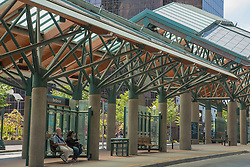 North America, United States, Washington, Bellevue, people waiting for bus at Transit Center