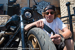Jesse Rooke at the Harley-Davidson plaza on Main Street during the annual Sturgis Black Hills Motorcycle Rally.  SD, USA.  August 7, 2016.  Photography ©2016 Michael Lichter.