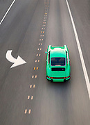 Image of a green 1974 Porsche 911 on a road in Redmond, Washington, Pacific Northwest by Randy Wells