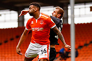 Wimbledon forward James Hanson (18) in an ariel battle  during the EFL Sky Bet League 1 match between Blackpool and AFC Wimbledon at Bloomfield Road, Blackpool, England on 20 October 2018.