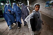 Burqa-clad women in jeans and sneakers walk on the street of Herat, Afghanistan on Thursday, April 5, 2007. Herat, unlike any other cities in Afghanistan, has 24-hour electricity, thanks to the help from Iran, and the women enjoys relative liberty also influenced by Iran. Many Herat women dare to wear jeans and sneakers, a symbol of Westernization, and some times wear chador, an Iranian influence. However, this city used to have a hard-line governor, Ismail Khan, who banned unrelated men and women from walking together in public, and if caught, they were medically examined in the hospital.