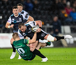 Sam Parry of Ospreys is tackled by Conor Fitzgerald of Connacht<br /> <br /> Photographer Simon King/Replay Images<br /> <br /> Guinness PRO14 Round 6 - Ospreys v Connacht - Saturday 2nd November 2019 - Liberty Stadium - Swansea<br /> <br /> World Copyright © Replay Images . All rights reserved. info@replayimages.co.uk - http://replayimages.co.uk