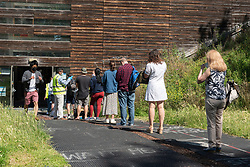 © Licensed to London News Pictures. 16/07/2021. London, UK. People queue up outside Little Venice Sports Centre to receive their first Covid vaccination as the UK recorded 48,553 new UK case of Covid 19, the highest daily figure since January 2021. Photo credit: Ray Tang/LNP
