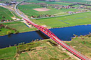 Nederland, Gelderland - Overijssel, Hattem, 01-05-2013; IJsselbrug, spoorbrug bij Hattem voor de Hanzelijn. Splitsing van de spoorlijn naar Kampen en Amersfoort.<br /> De 'Hanzeboog' is ontworpen door  Quist Wintermans Architecten.<br /> The red railway bridge Hanzeboog (Hanseatic arch) over the IJssel near Zwolle, has been designed by Quist Wintermans Architects. <br /> luchtfoto (toeslag op standard tarieven);<br /> aerial photo (additional fee required);<br /> copyright foto/photo Siebe Swart
