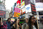Demonstrators pass through Piccadilly shouting at members of a far right movement at Anti-racism Day demonstration led by Stand Up To Racism on 19th March 2016 in London, United Kingdom. Stand Up To Racism has led some of the biggest anti-racist mobilisations in Britain of the last decade, making a stand protesting against racism, Islamophobia, anti-Semitism and fascism.