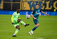 SAINT PETERSBURG, RUSSIA - NOVEMBER 04: Djavan Anderson of SS Lazio and Yuri Zhirkov of Zenit St Petersburg during the UEFA Champions League Group F stage match between Zenit St. Petersburg and SS Lazio at Gazprom Arena on November 4, 2020 in Saint Petersburg, Russia. (Photo by MB Media)