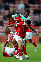 Football - 2020 / 2021 Sky Bet Championship - Play-offs - Semi-final 1st Leg - Barnsley vs Swansea City - Oakwell<br /> <br /> Jamal Lowe of Swansea City competes with Toby Sibbick and Alex Mowatt of Barnsley