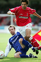 Photo:  Frances Leader.<br /> Swindon Town FC v Peterborough Utd.  Coca-Cola football league one.<br /> The County Ground.<br /> 11/09/2004<br /> Peterborough's Steve Jenkins tackle of Swindon's Rory Fallon for which he gets a yellow card.