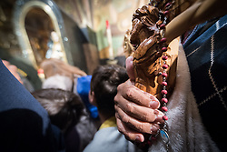 19 April 2019, Jerusalem: A man prays in the Church of the Holy Sepulchre. Thousands of Christians march the Via Dolorosa on Good Friday, marking the stations of the cross in the Jerusalem Old City, in memory of the path Jesus walked carrying his cross towards his crucifixion.