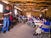"13 JULY 2012 - FT DEFIANCE, AZ:     JIMMY ETSITTY, a Navajo preacher, testifies about his rebirth in Christ in the chow hall at the 23rd annual Navajo Nation Camp Meeting in Ft. Defiance, north of Window Rock, AZ, on the Navajo reservation. Etsitty said he was raised to be a Navajo medicine man and that his family turned away from him when he became a Christian. Preachers from across the Navajo Nation, and the western US, come to Navajo Nation Camp Meeting to preach an evangelical form of Christianity. Evangelical Christians make up a growing part of the reservation - there are now more than a hundred camp meetings and tent revivals on the reservation every year. The camp meeting in Ft. Defiance draws nearly 200 people each night of its six day run. Many of the attendees convert to evangelical Christianity from traditional Navajo beliefs, Catholicism or Mormonism. ""Camp meetings"" are a form of Protestant Christian religious services originating in Britain and once common in rural parts of the United States. People would travel a great distance to a particular site to camp out, listen to itinerant preachers, and pray. This suited the rural life, before cars and highways were common, because rural areas often lacked traditional churches.PHOTO BY JACK KURTZ"