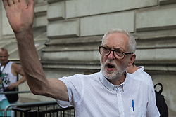 London, UK. 20th July, 2021. Former Labour Party leader Jeremy Corbyn waves away anti-vaccination activists disrupting his interview regarding the NHSPay15 campaign outside Downing Street. He had just accompanied NHSPay15 campaigners to the door of 10 Downing Street to present a petition signed by over 800,000 people calling for a 15% pay rise for NHS workers.
