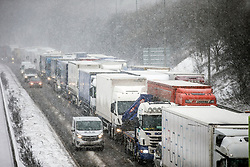 © Licensed to London News Pictures. 01/03/2018. Huddersfield UK. Traffic is at a standstill due to snow on the M62 West bound near Huddersfield as the Beast from the East continues to batter the UK. Photo credit: Andrew McCaren/LNP
