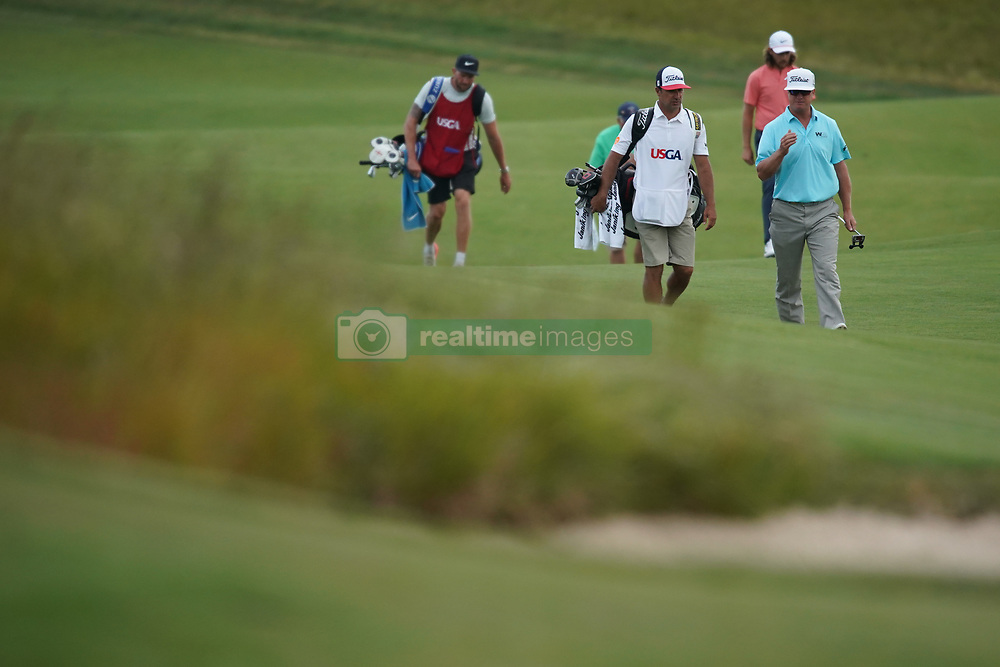 June 16, 2018 - Southampton, NY, USA - Charley Hoffman approaches the 14th green during the third round of the 2018 U.S. Open at Shinnecock Hills Country Club in Southampton, N.Y., on Saturday, June 16, 2018. (Credit Image: © Brian Ciancio/TNS via ZUMA Wire)