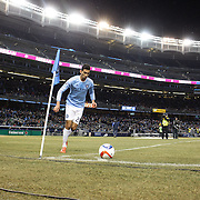 Mehdi Ballouchy, NYCFC, takes a corner  during the New York City FC Vs Sporting Kansas City, MSL regular season football match at Yankee Stadium, The Bronx, New York,  USA. 27th March 2015. Photo Tim Clayton