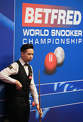 Xiao Guodong on day five of the Betfred Snooker World Championships at the Crucible Theatre, Sheffield.