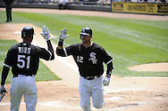 CHICAGO - MAY 22:  A.J. Pierzynski #12 celebrates with Alex Rios #51 of the Chicago White Sox after Pierzynski hit a home run against the Los Angeles Dodgers on May 22, 2011 at U.S. Cellular Field in Chicago, Illinois.  The White Sox defeated the Dodgers 8-3.  (Photo by Ron Vesely)  Subject:   A.J. Pierzynski;Alex Rios