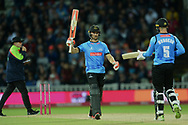 Laurie Evans of Sussex raises his bat on reaching his half-century during the final of the Vitality T20 Finals Day 2018 match between Worcestershire Rapids and Sussex Sharks at Edgbaston, Birmingham, United Kingdom on 15 September 2018.