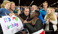 London, August 08 2017 . Conseslus Kipruto, Kenya, wishes a little girl happy birthday after storming to victory in the men's 3,000m steeplechase final on day five of the IAAF London 2017 world Championships at the London Stadium. © Paul Davey.
