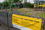 As the UK's Coronavirus pandemic lockdown continues into its 5th week, and UK deaths from Covid-19 reached 21,678 - a daily rise of 586, swings and climbing frames are deserted during seasonal rain Ruskin Park in Lambeth, where until now, this green space in south London has been busy with those exercising according to social distance requirements, on 28th April 2020, in London, England.