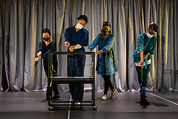 """© Licensed to London News Pictures. 11/05/2021. LONDON, UK. (L to R) Tina Chiang, Etta Fusi, Janet Etuk and Keziah Joseph perform at the preview at Shoreditch Town Hall of """"The Language of Kindness"""", a new work adapted and created by Sasha Milavic Davies and James Yeatman, based on Christie Watson's bestselling memoir of her twenty years as a nurse. The socially distanced, ensemble dance-theatre show celebrates nurses and front-line healthcare workers working for the NHS. It will premiere in Warwick in the first week that certain coronavirus lockdown restrictions are eased, before playing in Tunbridge Wells and London.  Photo credit: Stephen Chung/LNP"""