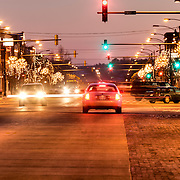 Traffic and light trails at intersection of Main St and Hwy 281 in rural Pratt, Kansas.