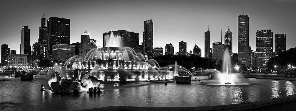 Buckingham fountain and the Chicago Skyline are seen at dusk.
