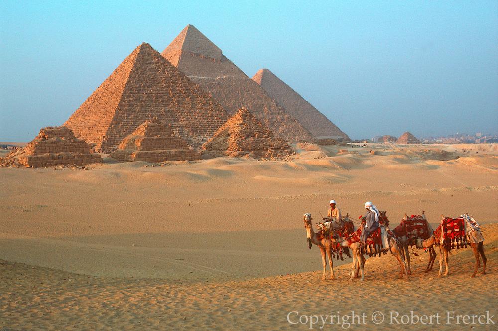 EGYPT, ANCIENT MONUMENTS Pyramids of Giza and camel caravan