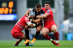 Henry Slade of Exeter Chiefs is tackled by Dan Cole of Leicester Tigers and Matt Scott of Leicester Tigers - Mandatory by-line: Ryan Hiscott/JMP - 15/08/2020 - RUGBY - Sandy Park - Exeter, England - Exeter Chiefs v Leicester Tigers - Gallagher Premiership Rugby