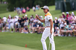 May 5, 2019 - Charlotte, North Carolina, United States of America - Rickie Fowler waves to the crowd after finishing up on the eighteenth hole during the final round of the 2019 Wells Fargo Championship at Quail Hollow Club on May 05, 2019 in Charlotte, North Carolina. (Credit Image: © Spencer Lee/ZUMA Wire)