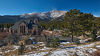 Saint Catherine of Siena Chapel (also know as the Chapel on the Rock, and St. Malo's Chapel) near Allenspark, Colorado. Mt. Meeker and Rocky Mountain National Park in the background. Image taken with a Nikon D2xs camera and 17-35 mm f/2.8 lens (ISO 100, 17 mm, f/10, 1/40 sec).