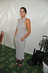 MICHELLE RODRIGUEZ at the 3rd day of the 2012 Glorious Goodwood racing festival at Goodwood Racecourse, West Sussex on 2nd August 2012.