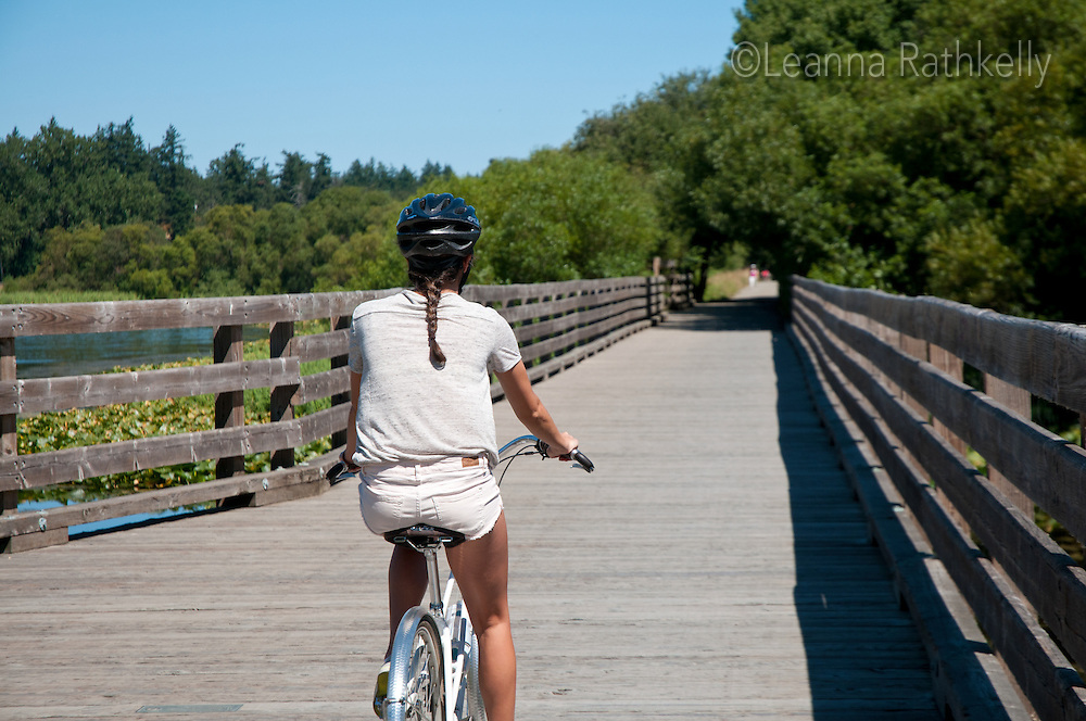 Taylor rides the Blenkinsop Trestle bridge, part of the Lochside Regional trails that connect downtown Victoria with the peninsula.