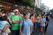 People waiting for a bus. Bangkok's bustling Chinatown (Sampeng) has an almost more authentic old China atmosphere and visual appearance than much of China itself. A compact area of shops Chinese signage, market stalls, food, transport workers and crowds, this area is in distinct contrast to Thai areas. Alleyways, narrow streets all fit together and are lined by shop-houses.