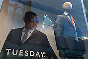 With the UK death toll reaching 34,813, with a further 541 victims in the last 24hrs, the governments pandemic lockdown has eased to another stage and shop mannequins stand in the window of a menswear retailer with corporate offices in the background of the City of London, the capitals financial district, on 1st June 2020, in London, England.
