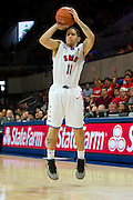 DALLAS, TX - FEBRUARY 6: Nic Moore #11 of the SMU Mustangs shoots a three-pointer against the Temple Owls on February 6, 2014 at Moody Coliseum in Dallas, Texas.  (Photo by Cooper Neill) *** Local Caption *** Nic Moore