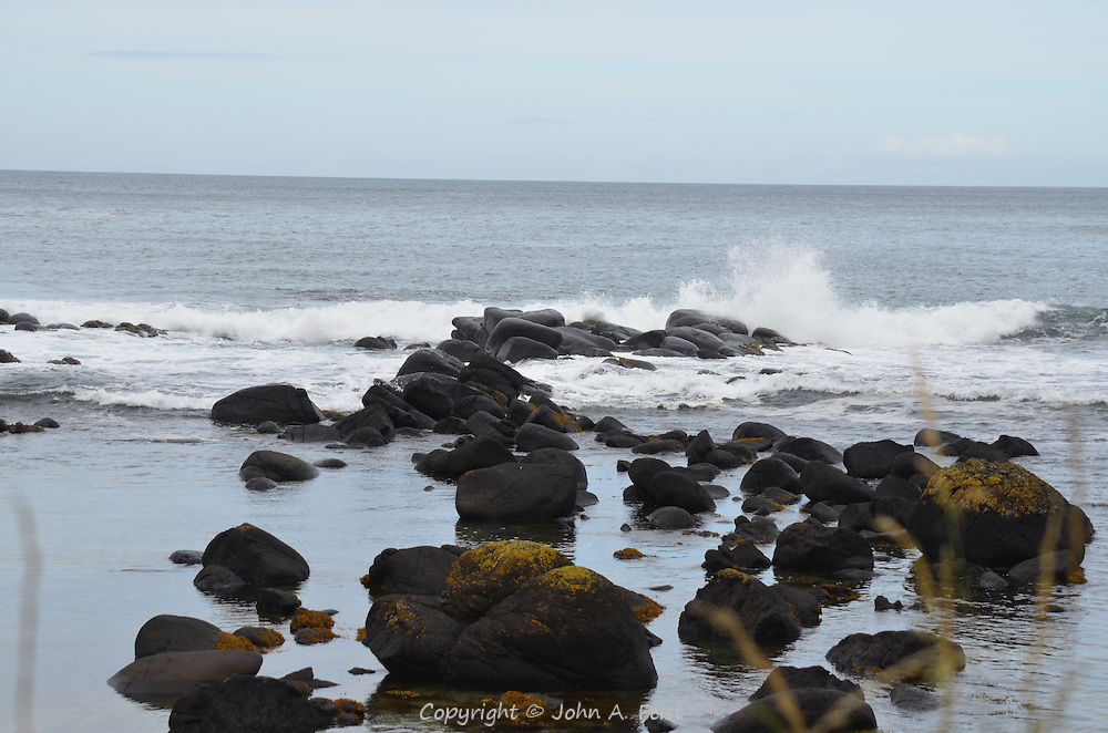 Waves crashing into the basalt rocks, looking out from the Giant's Causeway, County Antrim, Northern Ireland.