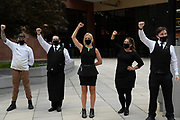 Restaurant workers raise their fists in solidarity with the protesters in Nashville, TN June 4, 2020
