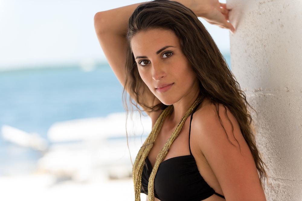 Close up portrait of Latin American woman against in a tropical beach with blur background