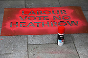 Campaigners against a Heathrow airport expansion spray paint the windows of the Labour party HQ, June 04 2018, Central London, United Kingdom. The activists want to make Labour vote no to a proposed expansion of the airport at a future parliamentary vote. All the paint is easily removes and leaves no stain. 8 were arrested.