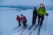 Michelle Blade (l-r), Mylène Jacquemart, Stefan Schöttl, and Nate Stevens pose on the summit of Trollsteinen, Svalbard.