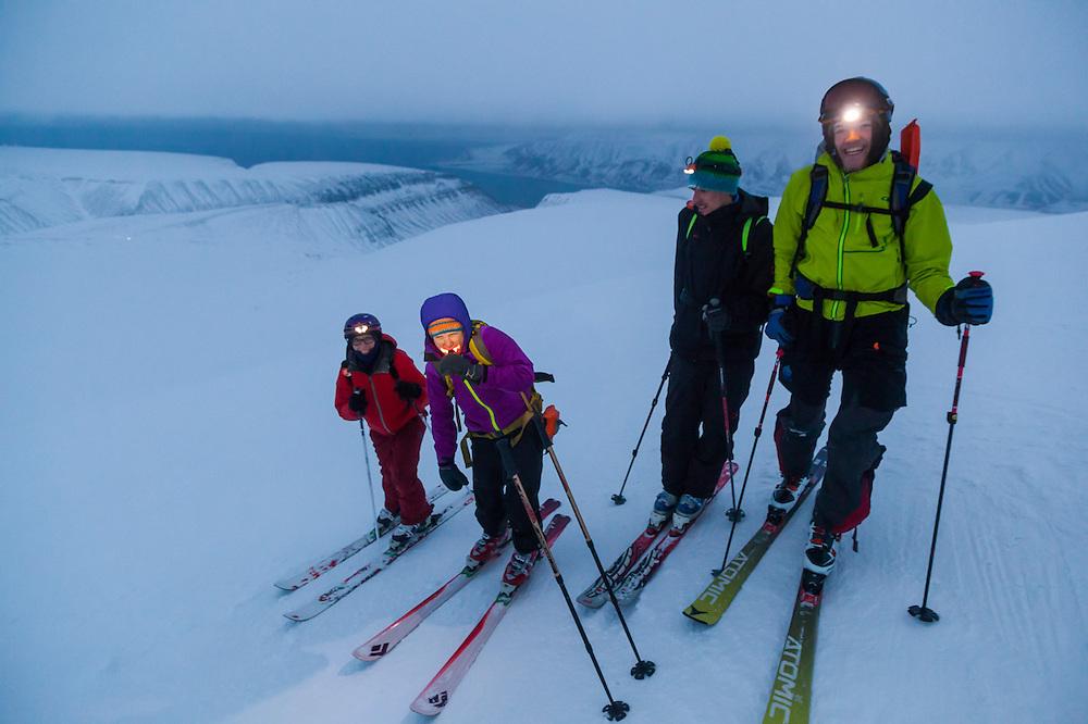 Michelle Blade (l-r), Mylène Jacquemart, Stefan Schöttl, and Nate Stevens pose on the summit of Trollsteinen, Svalbard.