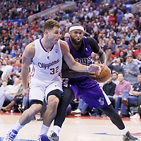 23 November 2013: Sacramento Kings center DeMarcus Cousins (15) drives past Los Angeles Clippers power forward Blake Griffin (32) during the Los Angeles Clippers 103-102 victory over the Sacramento Kings at the Staples Center, Los Angeles, California, USA.