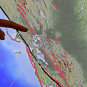 A monitor from the Berkeley Seismological Lab shows aftershock earthquake info as seen from a recording station located in Berkeley, California, on Sunday, August 24, 2014. A 6.1 magnitude earthquake caused significant damage and left three critically injured in California's northern Bay Area early Sunday, igniting fires, sending at least 87 people to a hospital, knocking out power to tens of thousands and sending residents running out of their homes in the darkness. Aftershocks are still being captured across the area by the data stations that are recording seismic data. (AP Photo/Alex Menendez)