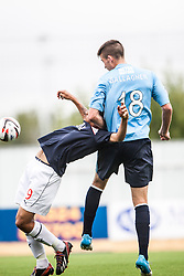 Falkirk's Phil Roberts held by Dundee's Declan Gallagher.<br /> Falkirk 3 v 1 Dundee, 21/9/2013.<br /> ©Michael Schofield.