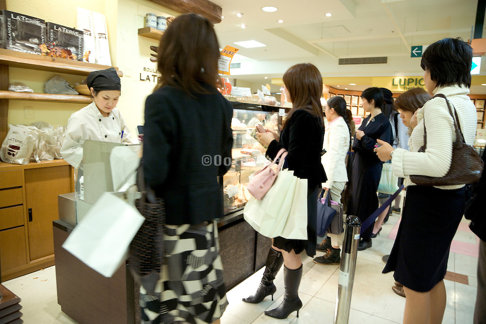 female customers waiting in line for ordering at a western style bakery Tokyo Japan