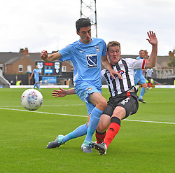 Coventry City's Peter Vincenti (left) battles with Grimsby Town's Paul Dixon (right)
