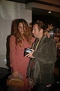Alexia Nieolzielska and Robert Astley Sparke, MILLA JOVOVICH, CARMEN HAWK & HARVEY NICHOLS CELEBRATE THE LAUNCH OF JOVOVICH-HAWK. FIFTH FLOOR CAFƒ. HARVEY NICHOLS. london.  27 April 2006. ONE TIME USE ONLY - DO NOT ARCHIVE  © Copyright Photograph by Dafydd Jones 66 Stockwell Park Rd. London SW9 0DA Tel 020 7733 0108 www.dafjones.com