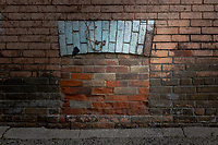 A bricked in basement window.
